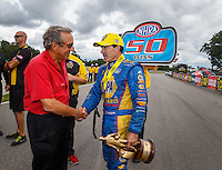 Aug 20, 2016; Brainerd, MN, USA; NHRA funny car driver Ron Capps (right) is congratulated by team owner Don Schumacher as he celebrates after winning the Protect the Harvest Nationals from Seattle, WA that was delayed by rain to run during qualifying for the Lucas Oil Nationals at Brainerd International Raceway. It was the 50th win of Capps career. Mandatory Credit: Mark J. Rebilas-USA TODAY Sports