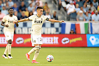 KANSAS CITY, KS - JUNE 26: Eduard Atuesta #20 Los Angeles FC with the ball during a game between Los Angeles FC and Sporting Kansas City at Children's Mercy Park on June 26, 2021 in Kansas City, Kansas.