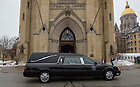 Mar. 3, 2015; The hearse with the casket of President Emeritus Rev. Theodore M. Hesburgh arrives in front of the Basilica of the Sacred Heart before the visitation and wake service. (Photo by Barbara Johnston/University of Notre Dame)