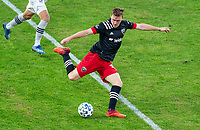 WASHINGTON, DC - NOVEMBER 8: Julian Gressel #31 of D.C. United crosses the ball during a game between Montreal Impact and D.C. United at Audi Field on November 8, 2020 in Washington, DC.