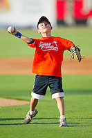 A young fan throws out a ceremonial first pitch prior to the start of the South Atlantic League game between the Augusta GreenJackets and the Kannapolis Intimidators at Fieldcrest Cannon Stadium June 24, 2010, in Kannapolis, North Carolina.  Photo by Brian Westerholt / Four Seam Images