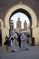 Fez, Morocco - Bab Bou Jeloud (Boujeloud), built 1913, the principal entrance into the medina of old Fez.  The minaret of the Bou Inania medersa is in the background.