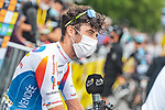 Pierre Latour (FRA) TotalEnergies at sign on before Stage 18 of the 2021 Tour de France, running 129.7km from Pau to Luz Ardiden, France. 15th July 2021.  <br /> Picture: A.S.O./Charly Lopez   Cyclefile<br /> <br /> All photos usage must carry mandatory copyright credit (© Cyclefile   A.S.O./Charly Lopez)