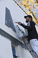 GIMME AN 'A'<br />Cameron Crook with NWA House Painers spruces up lettering Wednesday Nov. 18 2020 on the former Harris Bakery building in downtown Rogers. The building, at Second and Elm streets, is being refurbished. Go to nwaonline.com/201119Daily/ to see more photos.<br />(NWA Democrat-Gazette/Flip Putthoff)