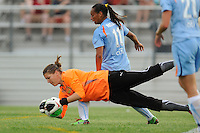 Goalkeeper Nicole Barnhart (1) of FC Gold Pride FC dives for a loose ball. Gold Pride defeated Sky Blue FC 1-0 during a Women's Professional Soccer (WPS) match at Yurcak Field in Piscataway, NJ, on May 1, 2010.