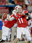 Southern Methodist Mustangs quarterback Garrett Gilbert (11)in action during the game between the University of Houston Cougars and the Southern Methodist Mustangs at the Gerald J. Ford Stadium in Dallas, Texas. SMU defeats Houston 72 to 42...