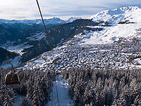 Switzerland. Canton Valais. Cable car above Verbier. Verbier is a village located in the municipality of Bagnes. The village lies on a south orientated terrace at around 1,500 metres facing the Grand Combin massif. The terrace lies on the east side of the Val de Bagnes. Verbier had 3000 permanent residents in 2010. The number of residents can rise to 35,000 in the winter season. Verbier is one of the largest holiday resort and ski areas in the Swiss Alps. 3.01.2012 © 2012 Didier Ruef