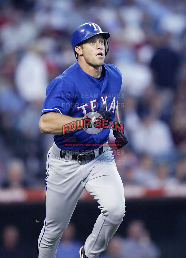 Gabe Kapler of the Texas Rangers runs the bases during a 2002 MLB season game against the Los Angeles Angels at Angel Stadium, in Los Angeles, California. (Larry Goren/Four Seam Images)