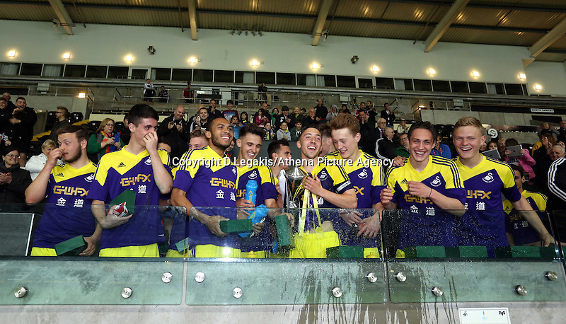 Thursday, 16 April 2014<br /> Pictured: Swansea Youth team celebrating winning the Cup.<br /> Re: FAW Youth Cup Final, Swansea City FC v The New Saints FC at the Liberty Stadium, south Wales,