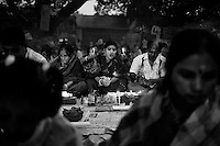 """During Kartik, """"the holiest month"""" beginning every year with the new moon in November, thousands of Hindu devotees celebrate the feast of Rakher Upobash, fasting and praying the gods sitting before the Shri Shri Lokanath Brahmachari Ashram, among the Swami Bagh Temple near Dhaka, Bangladesh. The worshippers offer candles called Prodip, meditate, give to charity, and generally perform austerity. <br /> A faithful absorbed in prayer.<br />  Barodi, Dhaka, Bangladesh. Nov. 11, 2014"""