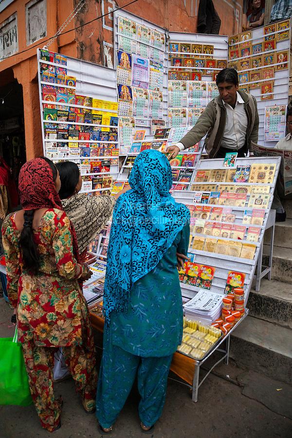 Jaipur, Rajasthan, India.  Women Shopping at a Shop Selling Hindu Religious Literature.