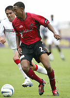 26 June 2004:   Dallas Burn Cory Gibbs in action against DC United at Cotton Bowl in Dallas, Texas.   DC United and Dallas Burn are tied 1-1 after the game.   Credit: Michael Pimentel / ISI