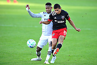 WASHINGTON, DC - NOVEMBER 8: Edison Flores #10 of D.C. United battles for the ball with Romell Quioto #30 of Montreal Impact during a game between Montreal Impact and D.C. United at Audi Field on November 8, 2020 in Washington, DC.