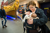 A mother breastfeeding her babyin a sling in a museum.<br /> <br /> London, England, UK<br /> 08/03/2015<br /> <br /> © Paul Carter / wdiip.co.uk