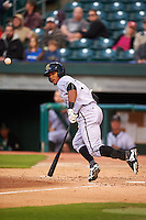 Jacksonville Suns outfielder Kenny Wilson (3) lays down a bunt during a game against the Chattanooga Lookouts on April 30, 2015 at AT&T Field in Chattanooga, Tennessee.  Jacksonville defeated Chattanooga 6-4.  (Mike Janes/Four Seam Images)