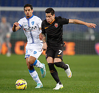 Calcio, Tim Cup: Roma vs Empoli. Ottavi di finale a gara unica. Roma, stadio Olimpico, 20 gennaio 2015.<br /> Empoli's Franco Signorelli and Roma's Juan Iturbe, right, fight for the ball during the Italian Cup round of 16 football match between Roma and Empoli at Rome's Olympic stadium, 20 January 2015.<br /> UPDATE IMAGES PRESS/Riccardo De Luca