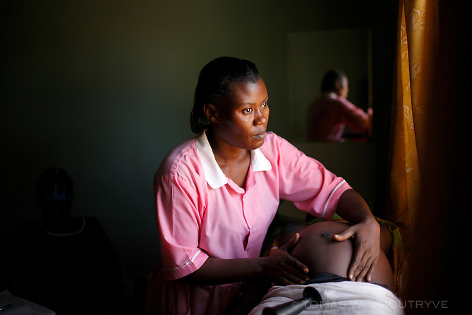 Namuwanga Sarah Justine, a nurse midwife, examines the belly of an HIV positive pregnant mother, during an ante-natal exam at the Kangulumira Health Centre in Uganda on 27 November 2008. CIFF funds work by the Ugandan NGO PREFA, including this health clinic that offers maternity services and care for HIV positive patients in addition to other medical treatment.