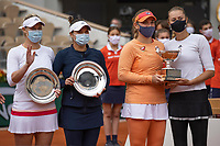 11th October 2020, Roland Garros, Paris, France; French Open tennis, Womens Doubles final 2020; Timea BabHun and Kristina Mladenovic Fra celebrate their win with losing finalists Alexa Guarachi and Desirea Krawczyk
