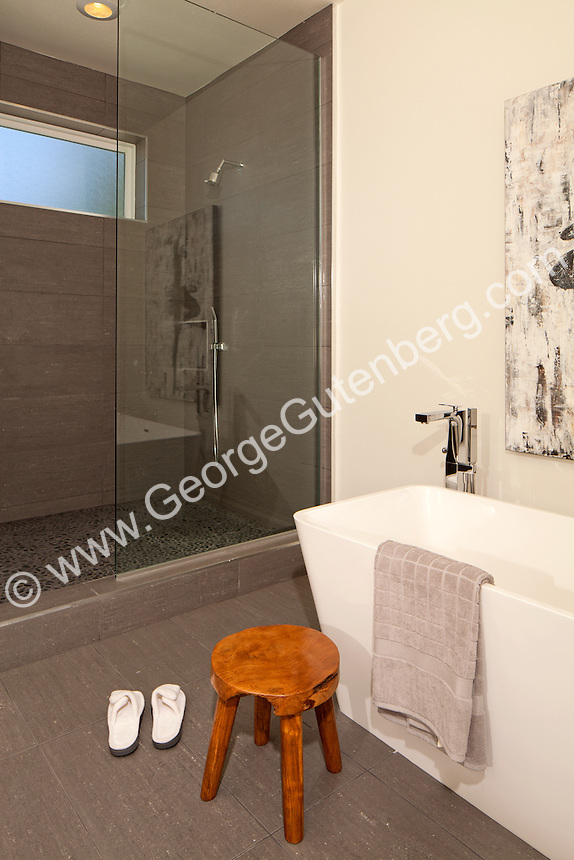 Stock photo of soaker bathtub, stool, towel and slippers