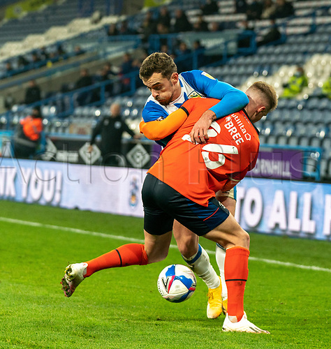 7th November 2020 The John Smiths Stadium, Huddersfield, Yorkshire, England; English Football League Championship Football, Huddersfield Town versus Luton Town; Harry Toffolo of Huddersfield Town tussles for possession with James Bree of Luton Town