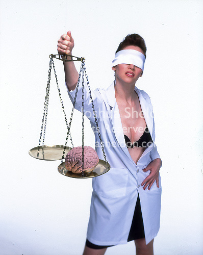 Busty blindfolded woman in lab coat holding scales weighing brain