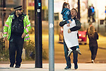 © Joel Goodman - 07973 332324 . 23/05/2017. Manchester, UK. Father ANDREW SENIOR carries his daughter EMILIA SENIOR away from the arena . Anxious parents wait by the police cordon for news of children inside the Manchester Arena . Police and other emergency services are seen near the Manchester Arena after Salman Abedi murdered 22 and injured dozens more at an Ariana Grande concert at Manchester Arena . Photo credit : Joel Goodman