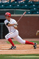 Chattanooga first baseman Adam Rosales (27) follows through on his swing versus Mississippi at AT&T Field in Chattanooga, TN, Wednesday, July 25, 2007.