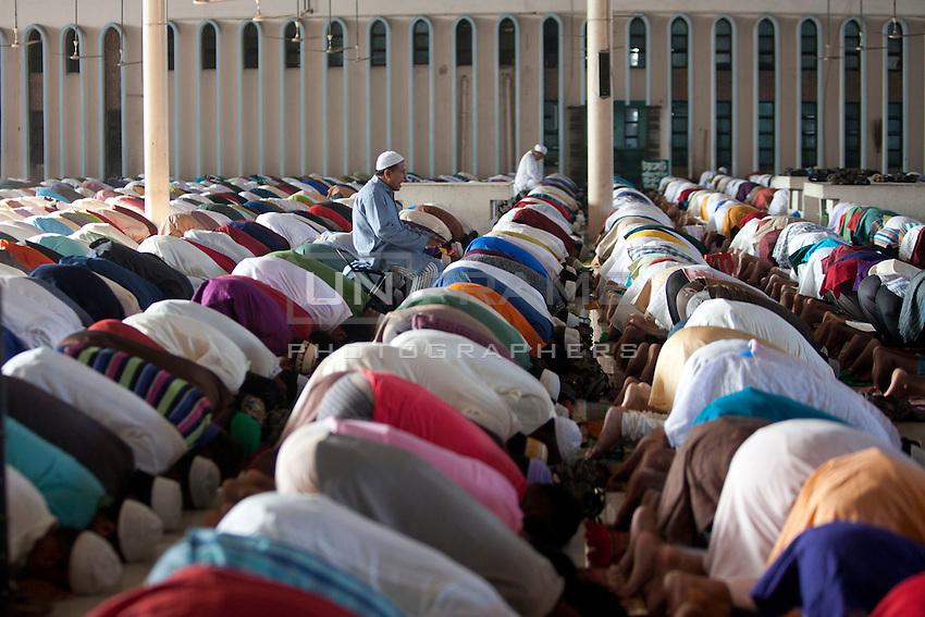 Bangladeshi Muslims offer prayers marking the festival of Eid al-Adha at the Baitul Mukarram National mosque in Dhaka, Bangladesh. Oct. 6, 2014