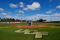 General view of the lineup exchange between Siena Saints head coach Tony Rossi (40) and UCF Knights head coach Terry Rooney with umpires Travis Carlson (center), Josh Miller (right), and Hank Himmanen (left) on February 21, 2016 at Jay Bergman Field in Orlando, Florida.  UCF defeated Siena 11-2.  (Mike Janes/Four Seam Images)