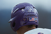 A closeup of the stickers on the batting helmet worn by Daylan Nanny (9) of the Western Carolina Catamounts during the game against the St. John's Red Storm at Childress Field on March 13, 2021 in Cullowhee, North Carolina. (Brian Westerholt/Four Seam Images)