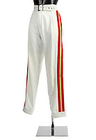 BNPS.co.uk (01202 558833)<br /> Pic: Bonhams/BNPS<br /> <br /> A pair of flamboyant trousers Freddie Mercury wore during Queen's final tour have sold for over £20,000.<br /> <br /> The iconic white bottoms feature two red and gold stripes down the outside legs and were paired by Mercury with a trademark white vest and yellow military-style jacket.<br /> <br /> He wore the trousers throughout Queen's 1986 'Magic' tour which included two sold-out shows at the old Wembley Stadium.<br /> <br /> They were bought for £450 at a charity auction in 1987 by Queen fan Susie Mitchell who has now sold them on.