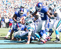 The Carolina Panthers played the New York Giants at Bank of America Stadium in Charlotte, NC.  The Panthers won 38-0 for their first victory of the season.  The Giants dropped to 0-3.  Carolina Panthers quarterback Cam Newton (1) scores a touchdown.