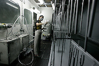 A worker at a paint spraying factory in Dongguan, China.