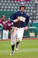 Joey Winiecki (11) of the Oral Roberts Golden Eagles crosses the plate during a game against the /m/ on March 27, 2011 at Hammons Field in Springfield, Missouri.  Photo By David Welker/Four Seam Images