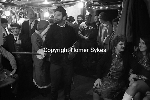 The Bampton Mummers. Bampton Oxfordshire England Christmas 1972. Mumming Play performance.The part of the Turkish Knight performed by Bampton resident William Daniels