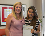 Brenda Henriquez, right, and Board Member Amanda Alfaro during the Nevada Women's Fund Scholarship distribution, June 20, 2019.