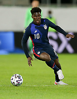 ST. GALLEN, SWITZERLAND - MAY 30: Yunus Musah #10 of the United States turns with the ball during a game between Switzerland and USMNT at Kybunpark on May 30, 2021 in St. Gallen, Switzerland.
