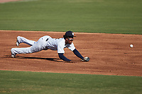 Charleston RiverDogs third baseman Abiezel Ramirez (2) makes a diving attempt at a ground ball during the game against the Augusta GreenJackets at Joseph P. Riley, Jr. Park on June 27, 2021 in Charleston, South Carolina. (Brian Westerholt/Four Seam Images)
