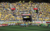 The teams and officials make their way onto the pitch during the A-League football match between Wellington Phoenix v Central Coast Mariners at Westpac Stadium, Wellington, New Zealand on Sunday, 25 March 2012. Photo: Dave Lintott / lintottphoto.co.nz