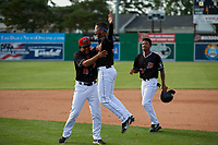 Batavia Muckdogs Jeremy Ovalle (19), Geremy Galindez (34), and Brayan Hernandez (23) celebrate after a walk off victory during a NY-Penn League game against the Auburn Doubledays on June 19, 2019 at Dwyer Stadium in Batavia, New York.  Batavia defeated Auburn 5-4 in eleven innings in the completion of a game originally started on June 15th that was postponed due to inclement weather.  (Mike Janes/Four Seam Images)