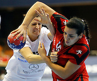 Tunisia's Manel Kouki (R) vies with Hungaryís Klara Szekeres (L) during their Women's Handball World Championship 2013 match Tunisia vs Hungary on December 9, 2013 in Novi Sad.   AFP PHOTO / PEDJA MILOSAVLJEVIC