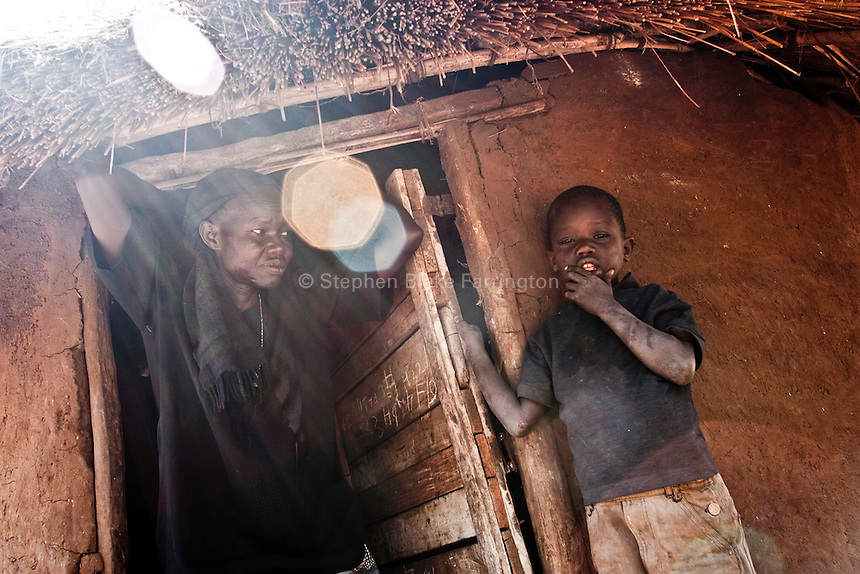 Africa, Sudan, Magwi County, Nimule, Caught In Between, Northern Uganda/Southern Sudan - The young boy pictured here was abducted by the Lord's Resistance Army and held for one day before his escape. During the attack of his village he witness the LRA kill his mother. While in custody of the LRA he also saw many beheadings upon other children. Thousands of children have been abducted, attacked, witnessed the killing of their families, raped, mauled, became soldiers, porters and sex slaves for the LRA. The war in Northern Uganda began in 1986 between the Lord's Resistance Army and the Ugandan People's Defense Forces (UPDF). The LRA has reigned terror and carnage on Northern Uganda and Southern Sudan ever since. The rebels commonly abduct children to fuel their personnel needs and quickly turn them into soldiers, porters and sexual slaves. The ongoing war has significantly damaged the region and has left an ongoing burden on the local population. December 2005 © Stephen Blake Farrington