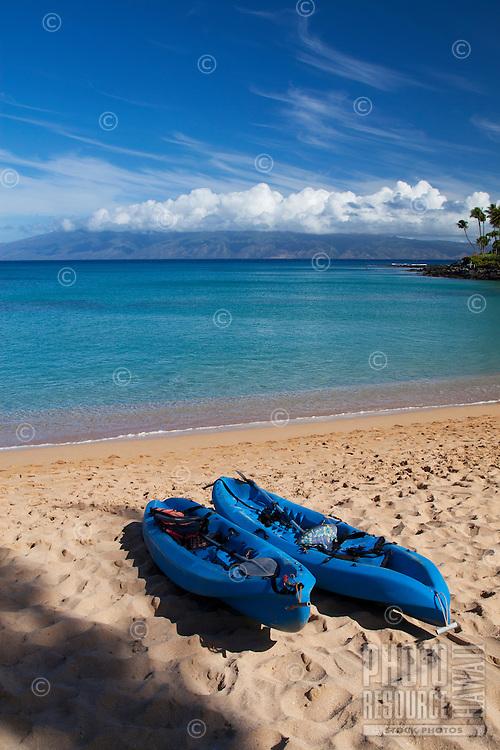 Kayaks on the beach at Napili Bay, Maui.