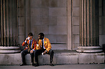 LIFFE, London International Financial Futures Exchange. Young traders having a lunch break. Sitting on the wall of the Bank of England. This  was all pre-computer trading, and is where deals were struck, Derivates, Options and Futures were bought and sold by shouting across the trading floor know at the 'Bear Pit' and frantic gesturing. They wore different coloured jackets so that colleagues could pick each other out in the frenzy of a days work.<br /> <br /> Man on left is Ian Bender and colleague Harry Daniels, they were working for Cargill Investor Services.