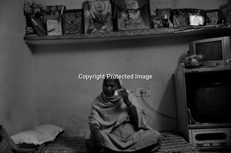 Surjit Kaur is a 1984 Sikh Genocide widow staying  in Tilak Vihar. Her husband Jivan Singh was burnt alive, caged in a burning tire around his neck. She witnessed her husband being burnt in front of her eyes.   The trauma makes her cry even today after 25 years. Tilak Vihar in New Delhi is called the widow colony. Widows and children of the Sikhs who were killed in 1984 Sikh Genocide live here. Four thousand Sikhs were killed in 72 hours in Delhi alone but no body till date has been punished for such an inhuman crime. Illiteracy, drug addiction, child labour and immense poverty characterize the area. Twenty five years ago all the male family members above the age of 15 were killed and burnt, leaving their uneducated widows and children behind to suffer, even after 25 years. The present generation is jobless, steeped in alcoholism and have lost their directions in life. November 2009. New Delhi, India, Arindam Mukherjee