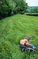 England, Offa's Dyke Footpath.  Weary Hiker Catching a Nap along the Trail.