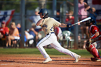 Mount St. Mary's Mountaineers first baseman Thomas Savastio (23) hits a single during a game against the Ball State Cardinals on March 9, 2019 at North Charlotte Regional Park in Port Charlotte, Florida.  Ball State defeated Mount St. Mary's 12-9.  (Mike Janes/Four Seam Images)
