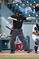 Home plate umpire Skyler Shown calls a batter out on strikes during the International League game between the Louisville Bats and the Charlotte Hornets at BB&T BallPark on June 22, 2019 in Charlotte, North Carolina. The Hornets defeated the Bats 7-6. (Brian Westerholt/Four Seam Images)
