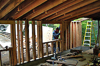 Construction workers work on the rough framing in residential construction in Sonoma County California