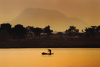 Fisherman on Jabi lake in Abuja, Nigeria.